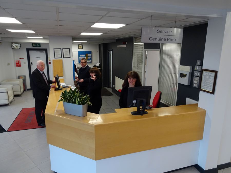 Reception desk with smiling staff